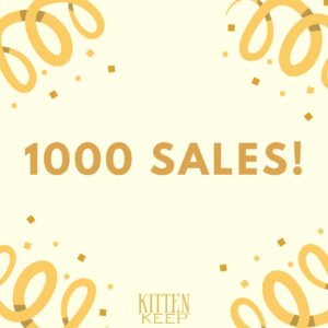 """Image with confetti and the text """"1000 sales"""", with the Kitten Keep text logo in gold at the bottom."""